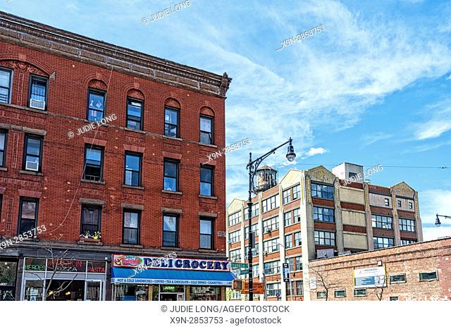 Brooklyn, NY, Greenpoint, Franklin Street. Typical Red Brick Tenement Block of Apartments Above and Retail Stores on the First Floor