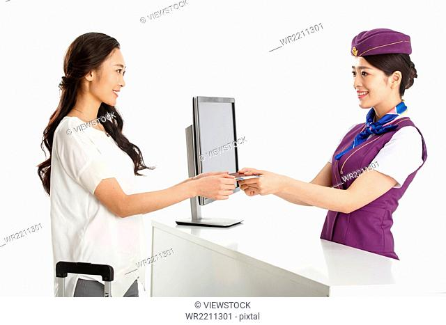 Young female flight attendants for customers to pass a passport
