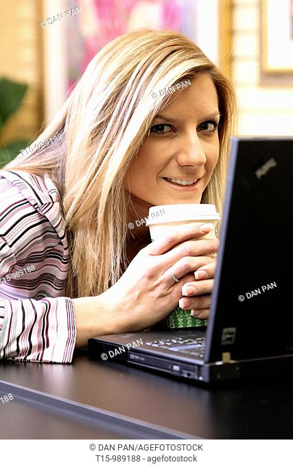 Woman smiling using computer