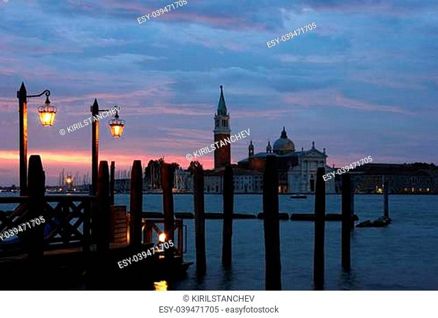 Romantic view of Venice with two lampposts in the early morning and San Giorgio Maggiore at the background