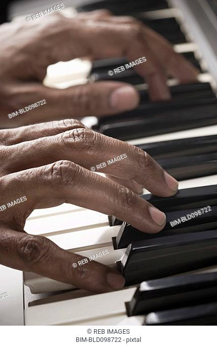 Mixed race man playing the piano