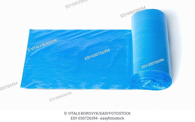 Roll of blue plastic garbage bags top view isolated on white background