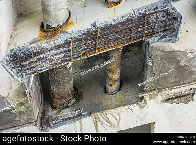 Repair work / renovation showing crumbling concrete and exposed reinforcing steel at Mariakerkebrug, 60s bridge in Mariakerke, East Flanders, Belgium
