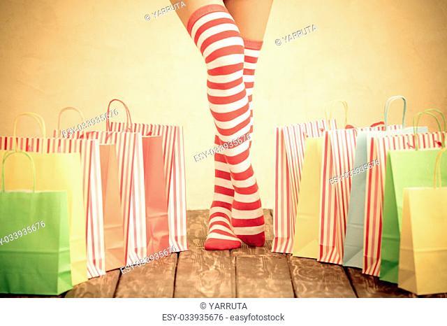 Sexy Santa woman legs. Christmas shopping concept