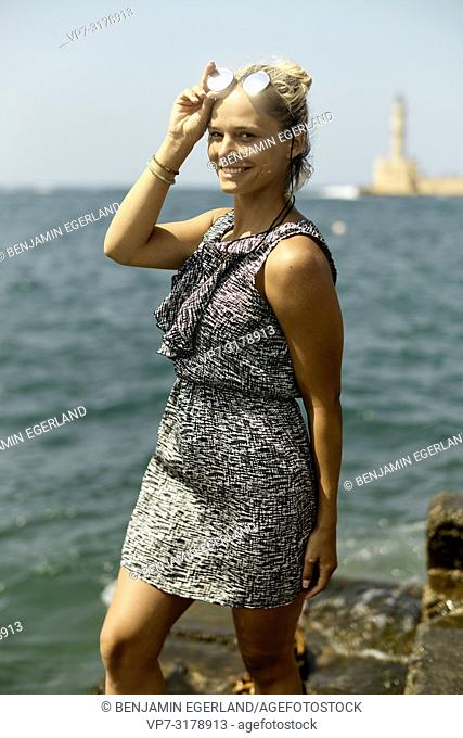 young woman at harbour in Chania, Crete, Greece