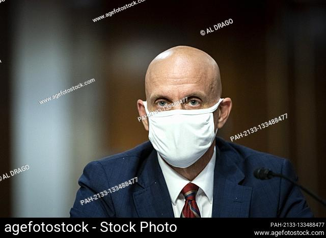 Stephen Hahn, Commissioner, United States Food and Drug Administration (FDA), wears a protective covering during a Senate Health, Education