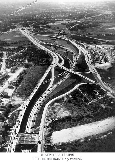 Aerial view of limited access highway on Long Island. The new roads provide access from the growing suburbs to New York City. Ca. 1946