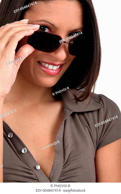 Woman peering over her sunglasses