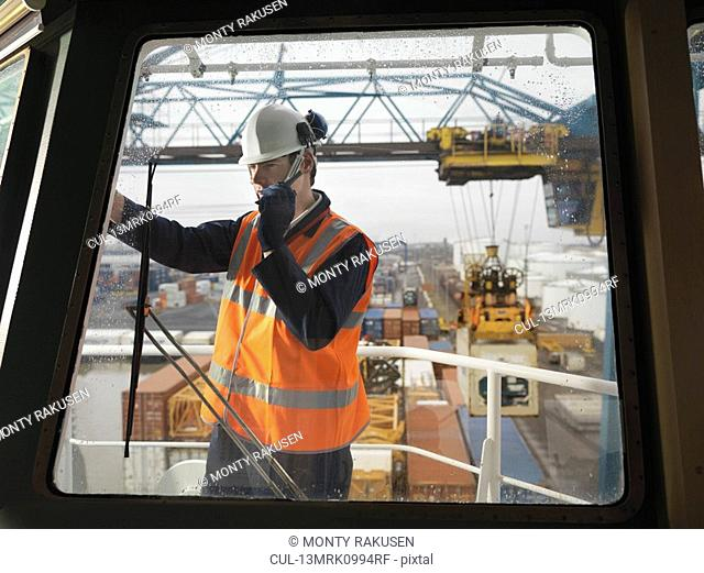 Port Worker With Walkie Talkie On Ship