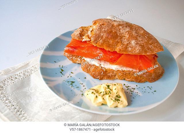Spanish tapa: sandwich of smoked salmon and cheese cream
