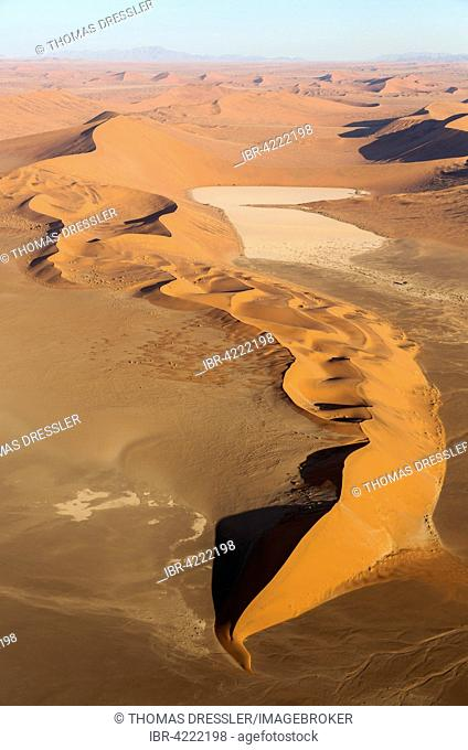 Sand dunes and dry pans in the Namib Desert, in the evening, aerial view, Namib-Naukluft National Park, Namibia