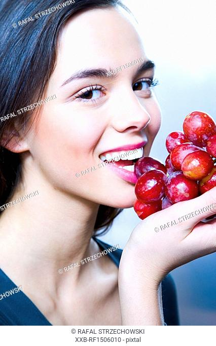 beauty young woman with grapes