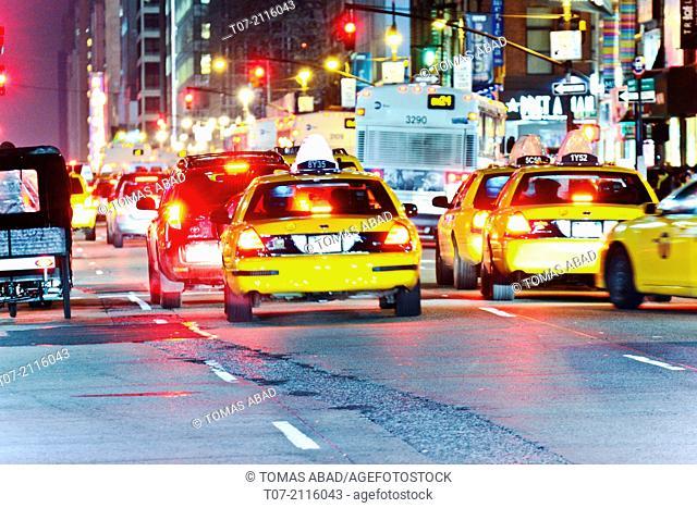 Rush Hour mass transit traffic, Public Transportation, Yellow Taxis, Herald Square, 34th Street, Midtown Manhattan, Broadway, Fashion District, New York City