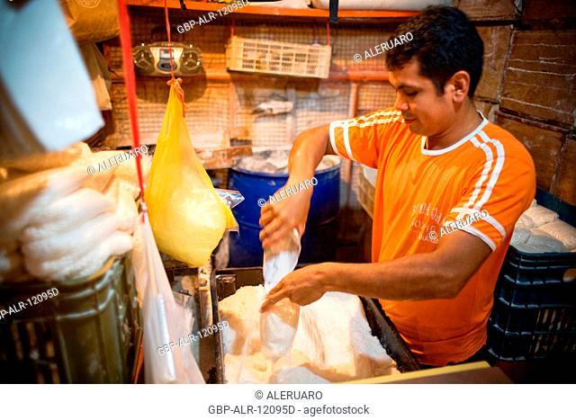 Man Packing Flour, Barão de São Domingos Collapse, Fair of the Fish, Amazônia, Manaus, Amazonas, Brazil