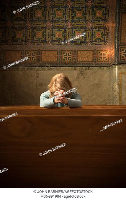 Woman Praying in Church