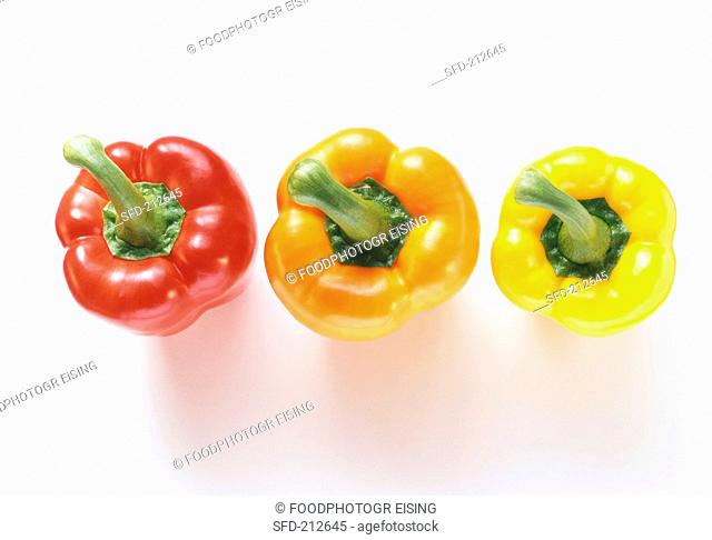 Red, orange and yellow pepper tops