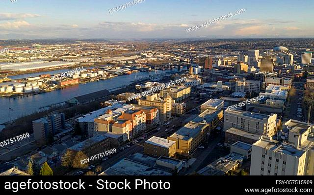 The Sun is low in the sky late afternoon over the urban city skyline of Tacoma Washington