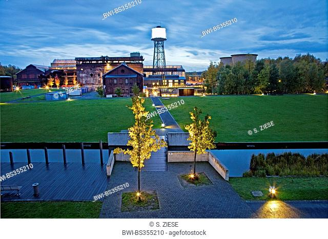 illuminated Westpark with Jahrhunderthalle Bochum and water tower in evening light, Germany, North Rhine-Westphalia, Ruhr Area, Bochum