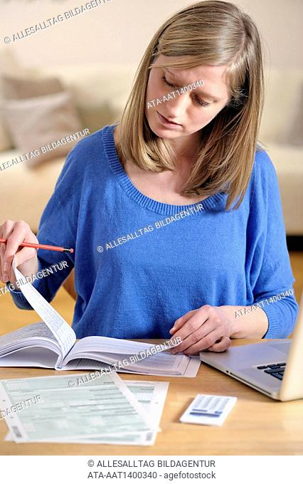 Woman is doing her annual tax declaration