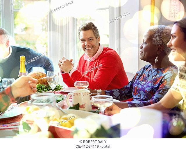 Portrait smiling man enjoying Christmas dinner at table