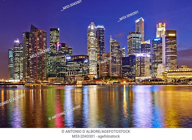 The Central Business District by night. In the foreground the water of Marina bay. Singapore
