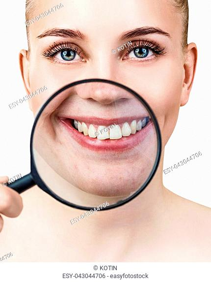 Woman with magnifying glass present teeth before whitening. Over white background