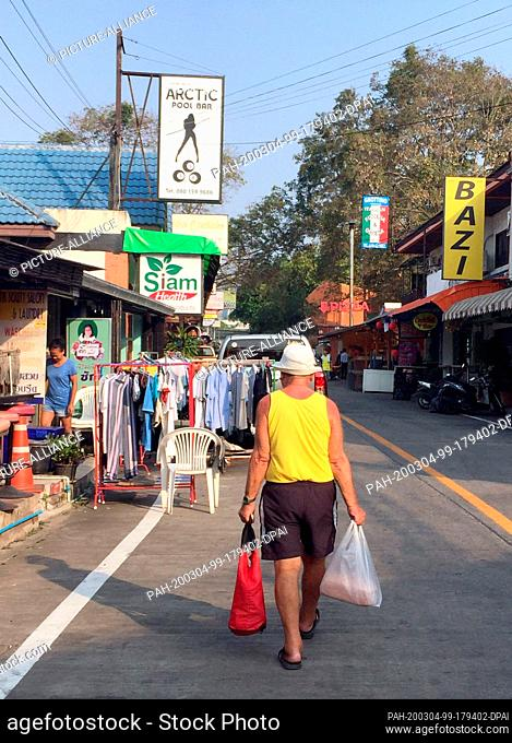 08 February 2020, Thailand, Pattaya: A man walks down a street. The Thai coastal city attracts many Germans, including holidaymakers and pensioners