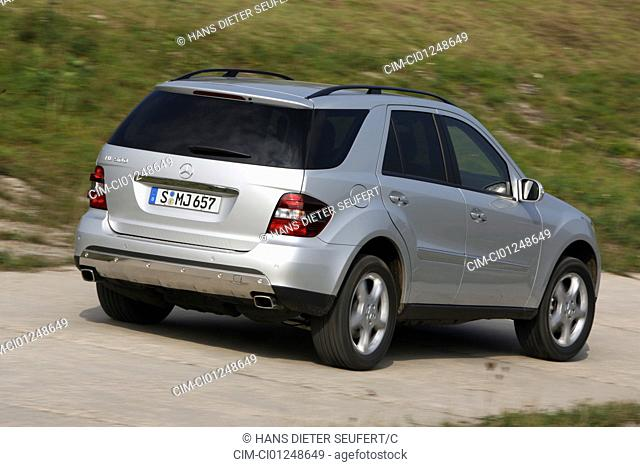 Mercedes ML 500, model year 2005-, silver, driving, diagonal from the back, rear view, country road