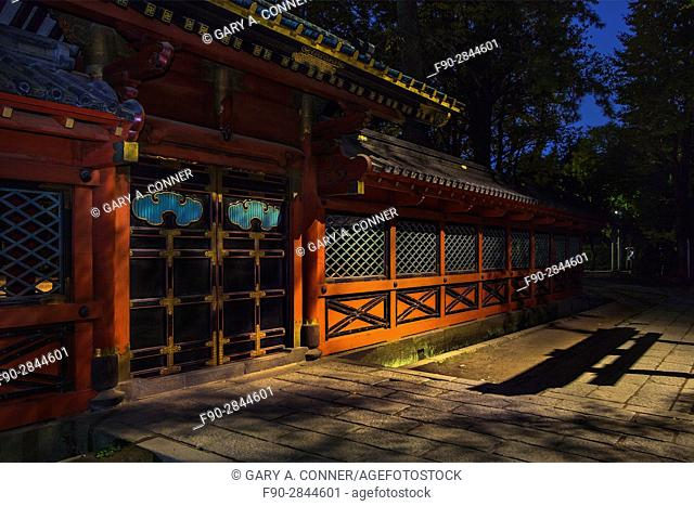 Nezu Shrine wall with shadow of torii gate in the evening, Tokyo, Japan