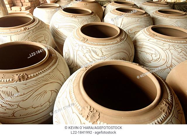 Nwe Nyein is a town of pottery  Almost all the inhabitants earn their living by making various designs of pot  Along the Irrawady river  Mandalay Division...
