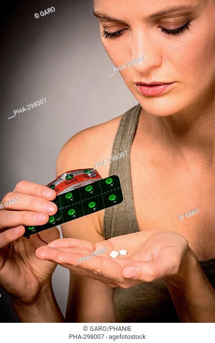 Woman taking Baclofene® tablets