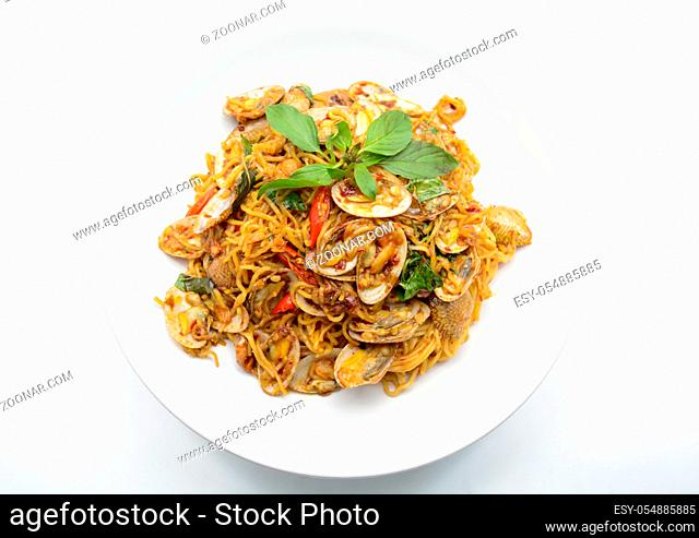 Stir fried noodles with clams and herbs, hot and spicy dish