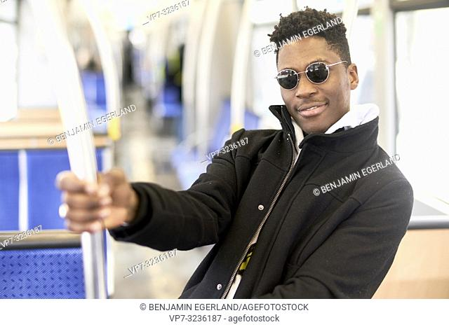 young man, in Munich, Germany.young man in tram, public transport, in Munich, Germany