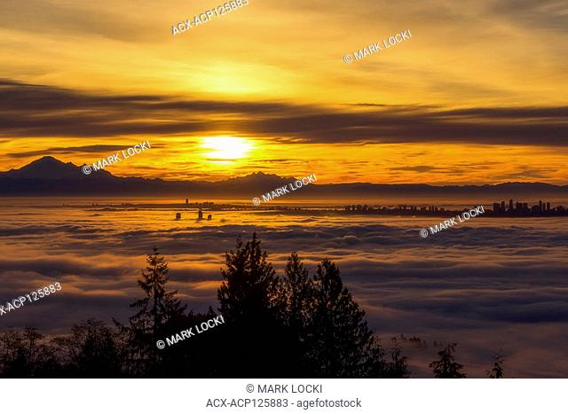 Sunrise over a cloud inversion from Cypress Provincial Park, Vancouver, British Columbia, Canada