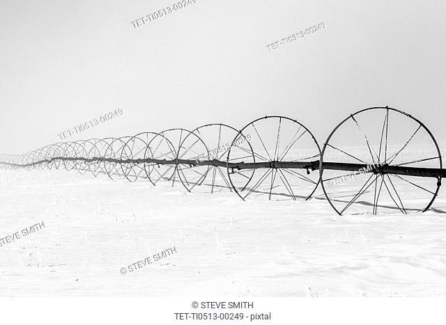 Sprinkler system on field during winter