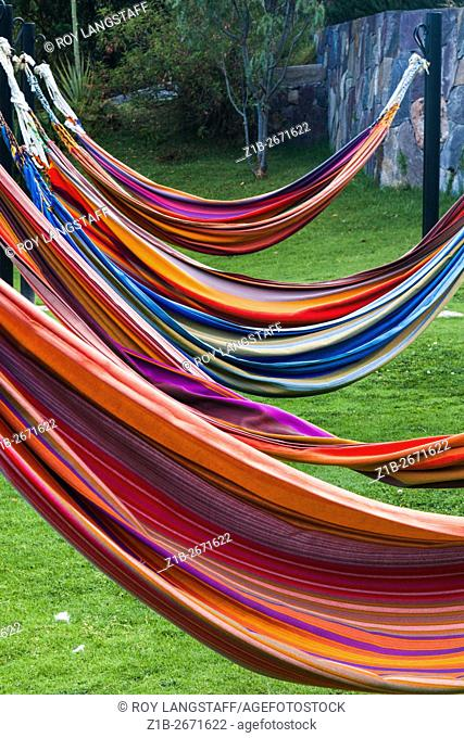 Abstract image of colourful hammocks ready for use