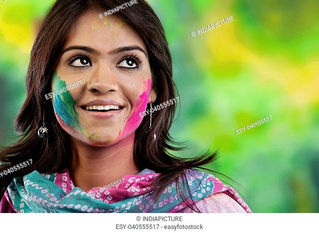 Woman with colour on her face
