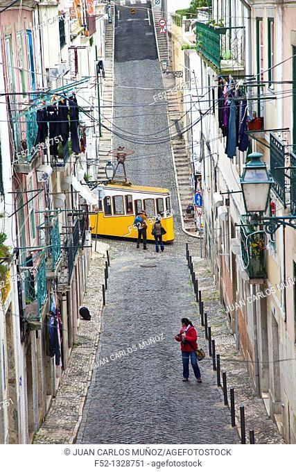 Bica funicular crossing the Travessa do Sequeiro street, Chiado district, Lisbon, Portugal