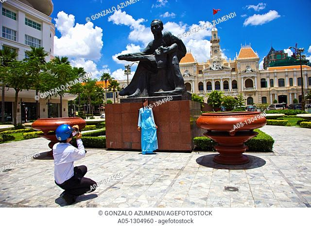 Ho Chi Minh Statue rocking to a child in front of City Hall. Ho Chi Minh City (formerly Saigon). South Vietnam
