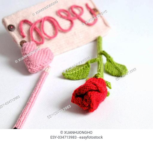 Amazing valentine background in pink colour, symbol of heart, i love you message, rose flower, all gift make handmade, knit from yarn