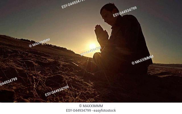 man praying sunset god sitting silhouette sun sunlight religion