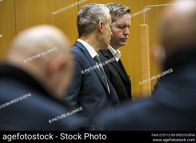 12 January 2021, Hessen, Frankfurt/Main: The main defendant Stephan Ernst (center, r) stands next to his lawyer Mustafa Kaplan (center