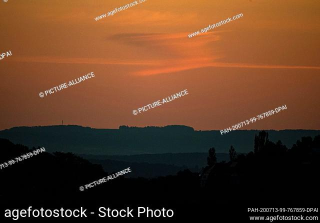 13 July 2020, Baden-Wuerttemberg, Stuttgart: A cloud formation can be seen above a forest on the horizon. Photo: Marijan Murat/dpa