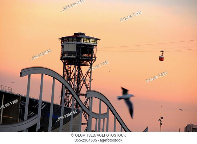Cable car tower in the sunset. Maremagnum area, Barcelona, Catalonia, Spain