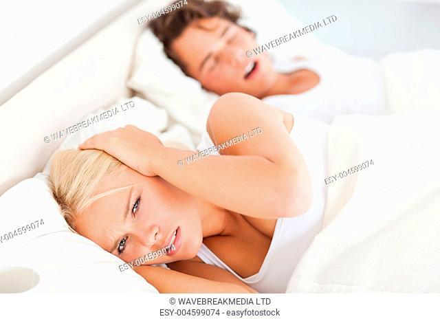 Angry woman awaken by her boyfriend's snoring