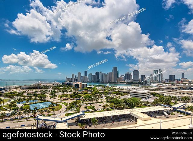 Miami, FL, United States - April 27, 2019: Downtown of Miami Skyline viewed from Dodge Island with Cruise terminal at Biscayne Bay in Miami, Florida, USA