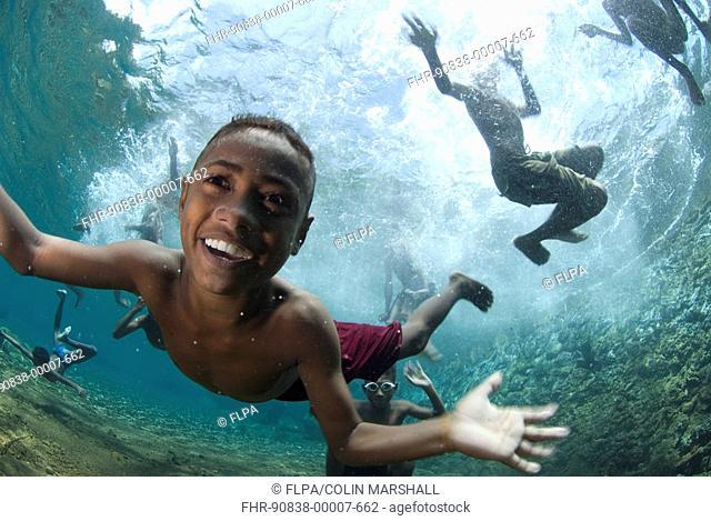 Children swimming and playing underwater, Pura Island, near Alor Island, Banda Sea, Lesser Sunda Islands, Indonesia