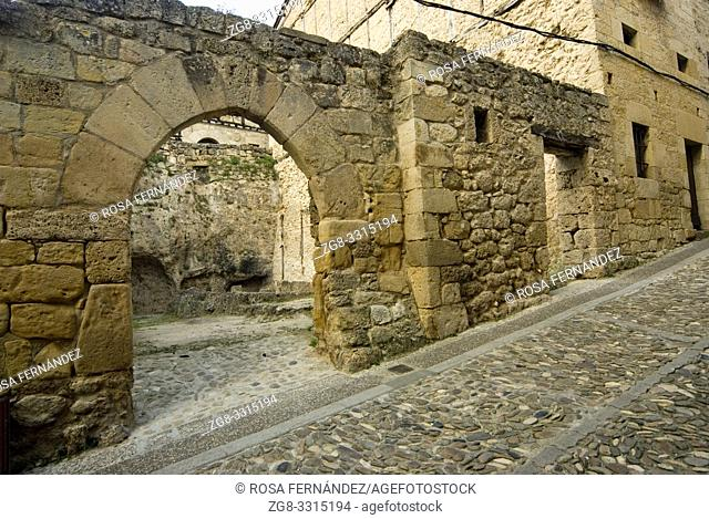 Street and ruin of ancient building with a stone arch, village of Frias, Las Merindades, province of Burgos, Spain