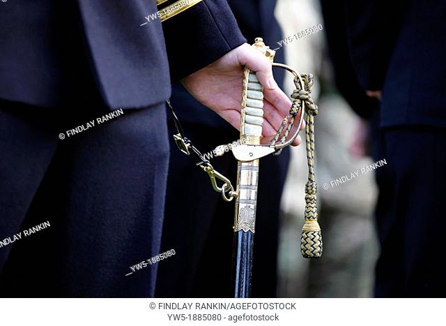 British Naval Officer holding his ceremonial sword while on parade