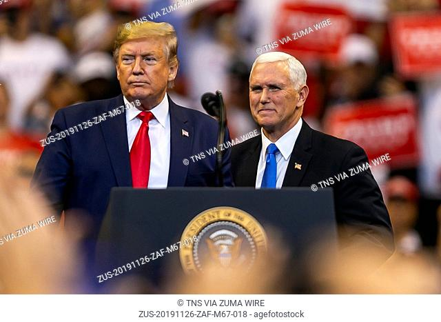 November 26, 2019, Sunrise, FL, USA: President Donald Trump, left, and Vice President Mike Pence attend a 'homecoming' rally at the BBT Center in Sunrise, Fla
